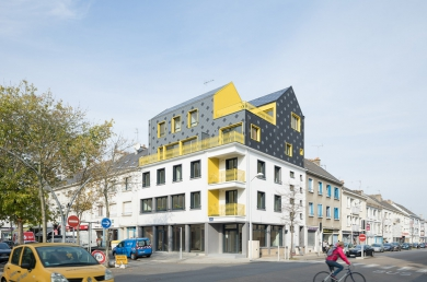 Rénovation et surélévation d'un immeuble du centre ville.