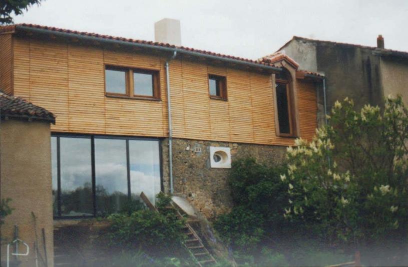 Surélévation et jonction entre deux corps de bâtiment d'une même habitation